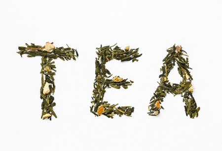 peal: green tea with orange peel and chamomile on white background