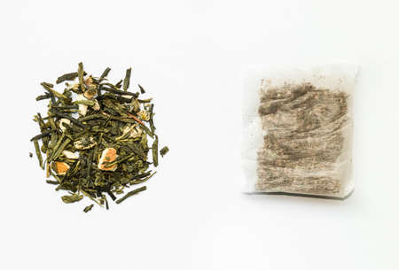 teabag: closeup of loose green tea and teabag
