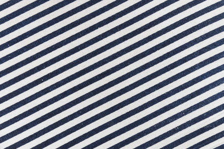 navy blue: closeup of navy blue diagonal striped textile Stock Photo