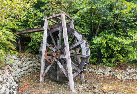 closeup of old wooden water mill wheel