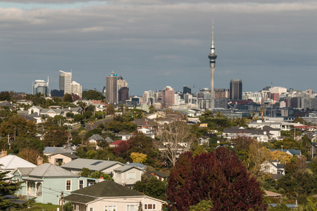 aerial view of Auckland suburb with skyscrapers in background Stock Photo