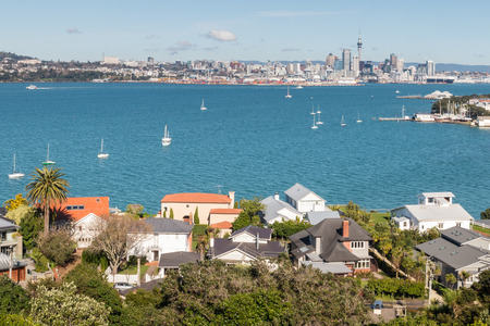 houses in Devonport suburb with Auckland CBD in background Stock Photo