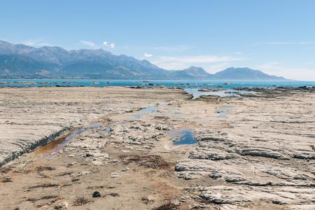 coastline with rock pools near Kaikoura, South Island, New Zealand Stock Photo