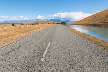 road and canal leading to Mount Cook National Park in Southern Alps, New Zealand
