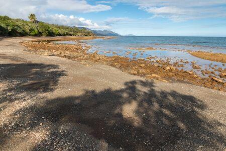 sandy beach near Plum on eastern coast of New Caledonia at low tide