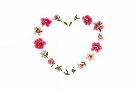 pink and white manuka tree flowers arranged in heart shape on white background