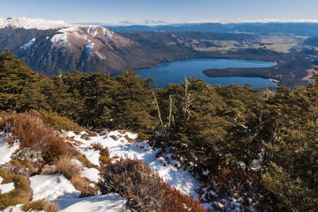 aerial view of Lake Rotoiti with snow covered Mount Robert range in Nelson Lakes National Park, New Zealand