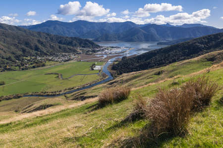 grassy hills above Havelock town and Pelorus Sound in Marlborough, South Island, New Zealand