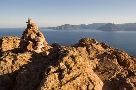 Rock pile on reef on Corsica seashore