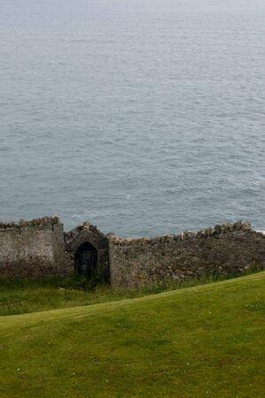 Stone wall on Irish seashore Stock Photo