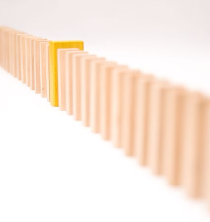 divergence: Queue of block with one yellow piece, conceptual image Stock Photo