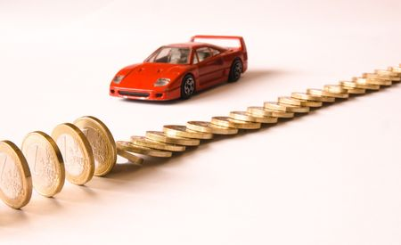Queue of euro coins falls, red italian car Stock Photo