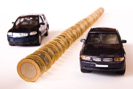 Queue of euro coins and two cars, conceptual image Stock Photo