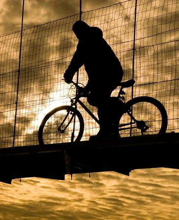 Silhouette of man on his way to the factory