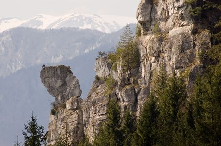 Man sitting on inaccessible rock and spacious nature around. Mala fatra, Slovakia. Stock Photo