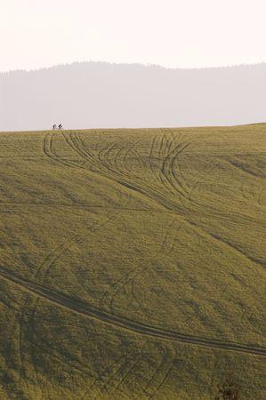 Two bikers far on horizont, north Slovakia