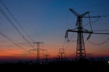 Power line runs to lights of big city Stock Photo