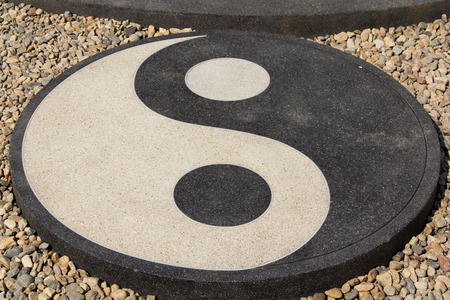 chinese philosophy: Yin Yang circle on the garden Stock Photo