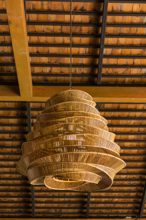 Wicker lamp on ceiling photo