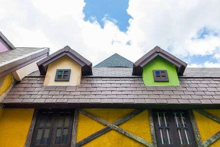 Colorful house design with the brown roof Stock Photo