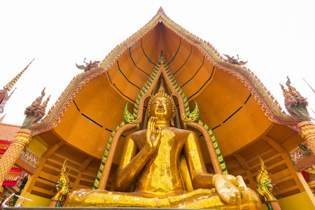 Big golden buddha statue decorated with mosaic inside the semi-circular dome. Statue in outdoor area of Wat Tham Sua(Tiger Cave Temple) Stock Photo