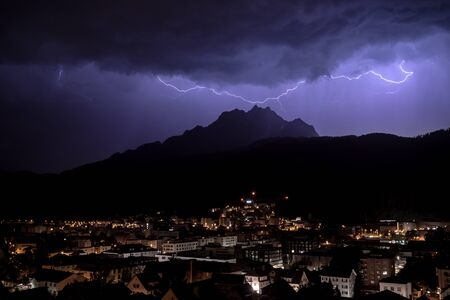 Forked lightning over Mount Pilatus purple violet sky ambiance city horw canton lucerne switzerland