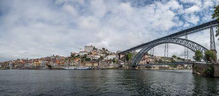 view from ribeira de gaia to famous bridge in porto portugal