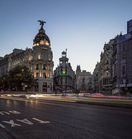 night photography light trails top view edificio metropolis at the corner of calle de alcala and gran via madrid spain