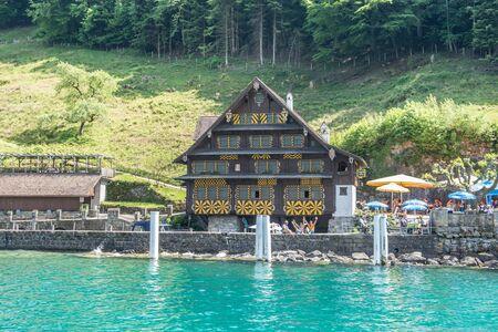 old building next to pier lake lucerne uri switzerland