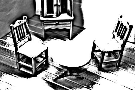 Black and White picture of a room: table, chairs, cupboard Stock Photo