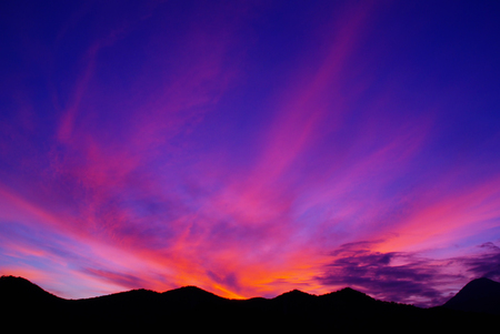 Beautiful Sunset Coloured Clouds over Mountain Range