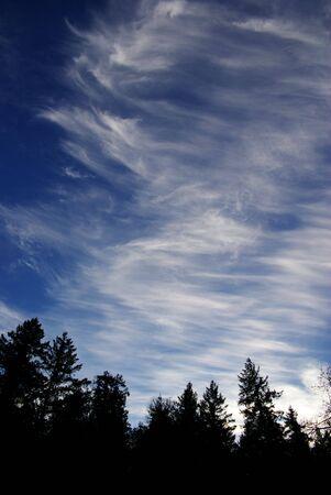 cirrus: cirrus clouds high in an alpine sky Stock Photo
