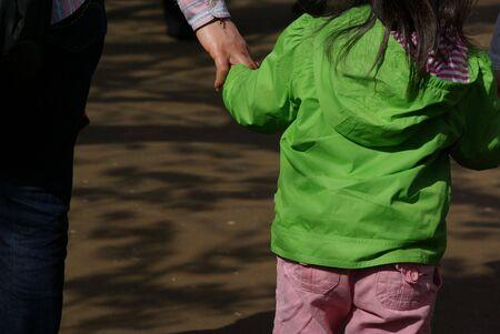 Child Holding Parents Hand 版權商用圖片