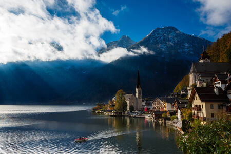View of the lake and the city of Hallstatt during fall season photo
