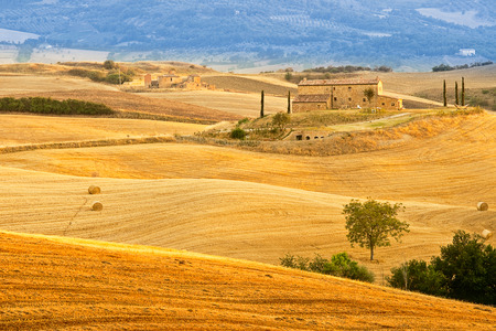 Lonely manor among harvested fields of Tuscany photo
