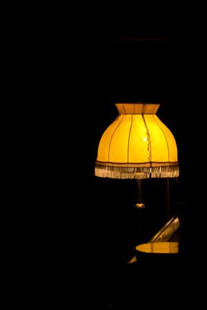 lamp shade: Desk lamp with the yellow lamp shade in the dark room