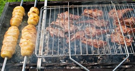 mutton chops: Mutton chops and potato on a grill