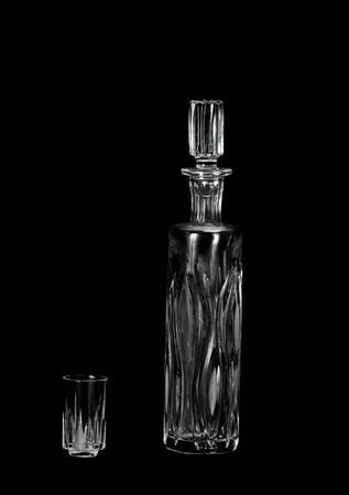 decanter: Crystal decanter and glass on black background