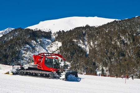 groomer: Snow groomer maintaining ski hills Stock Photo