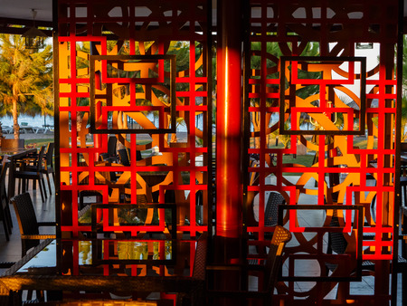 verandah: Wooden decorative lattice on a verandah of  Mexican restaurant shined with the morning sun Stock Photo