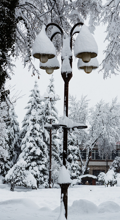 streetlights: Streetlights covered with a thick snow layer after heavy snowfall Stock Photo