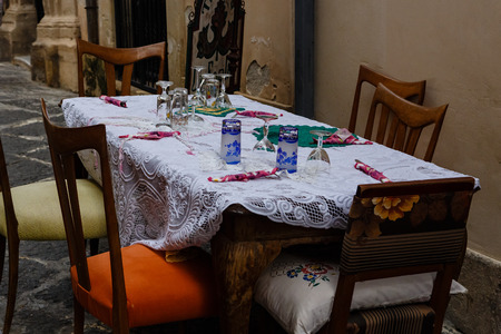 siracuse: Beautifully served table from tavern on narrow street of Siracuse, Sicily, Italy Stock Photo