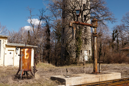 Ancient water tower and water crane for filling steam locomotive with water