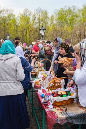 Moscow, Russia - April 27, 2019: Believing Muscovites consecrate in church Easter eggs and Easter cakes on the eve of a religious holiday of orthodox Easter