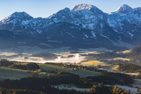 Morning fog in the valley in the Austrian Alps lit with the morning sun