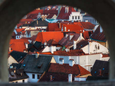View of the city of Cesky Krumlov through a castle window