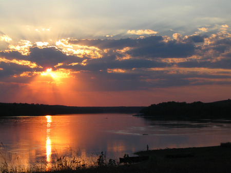 pleasent: Beautifull sunset over the Danube river; Awesome summer sunset landscape; Rays of sunshine in the water