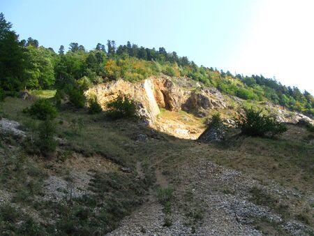 Rock quarry in Piatra Craiului Mountains Stock Photo