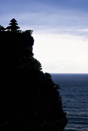 Pura Luhur Uluwatu on top of a clift overlooking Bali Strait photo