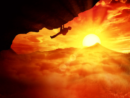 alpinist: Beautiful background with an alpinist trying climb a mount over the clouds sunset
